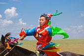 Young Boy Racing in Naadam Festival in Xiwuzhumuqi