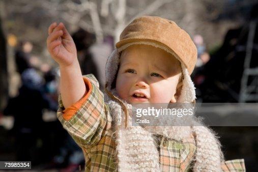 Young boy reaching