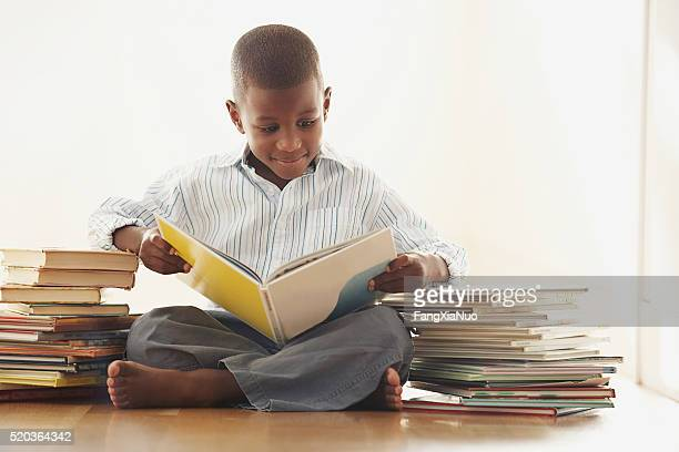 Young boy reading a storybook