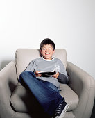 Young boy reading magazine