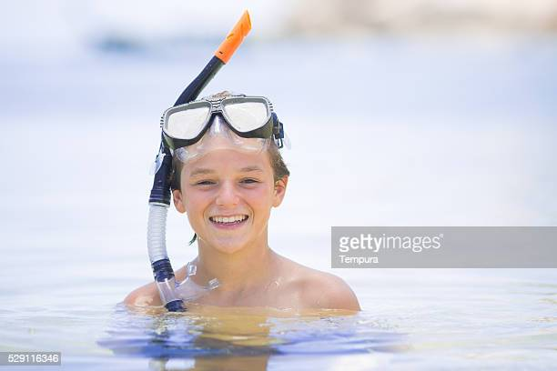 Young boy ready for snorkelling in an idilic island.