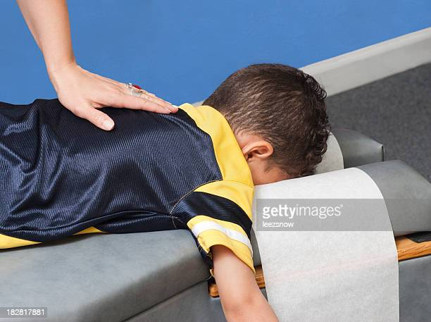 young boy receiving chiropractic care