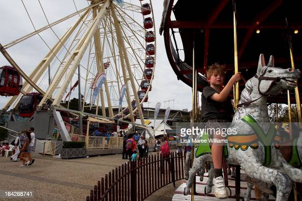 A young boy rides a carousel at the Sydney Royal Easter Show on March 22 2013 in Sydney Australia Organisers are expecting over 900000 visitors to...