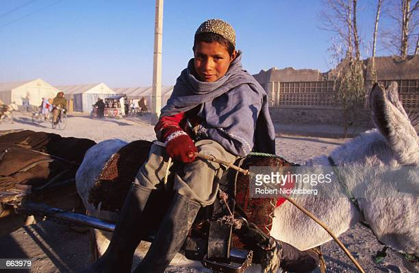 A young boy rides his donkey March 1 2000 in Kandahar Afghanistan