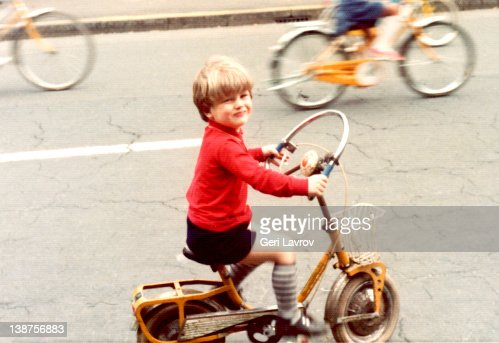 Young boy riding bicycle