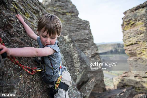 A young boy rock climbs at Frenchmans Coulee in Eastern Washington.