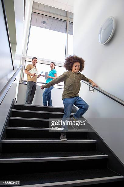 Young Boy Running Down Stairs