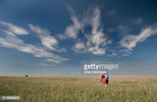 Young Boy Running in an Open Grassy Field