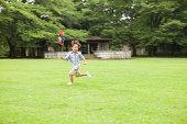 young boy running with pinwheel