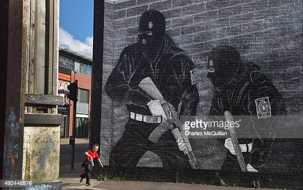 A young boy runs past a loyalist paramilitary mural on the day that the new Loyalist Community Council was launched at the Park Avenue Hotel on...