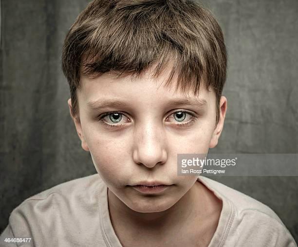 Young boy sad face