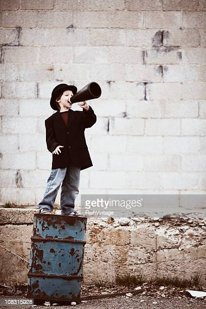 Young Boy Salesman Yells Through Megaphone