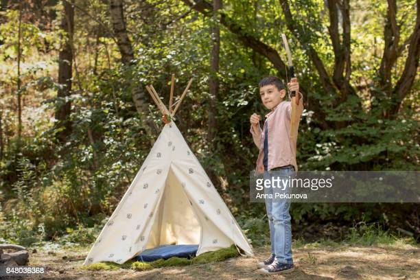 Young boy shooting with archery bow