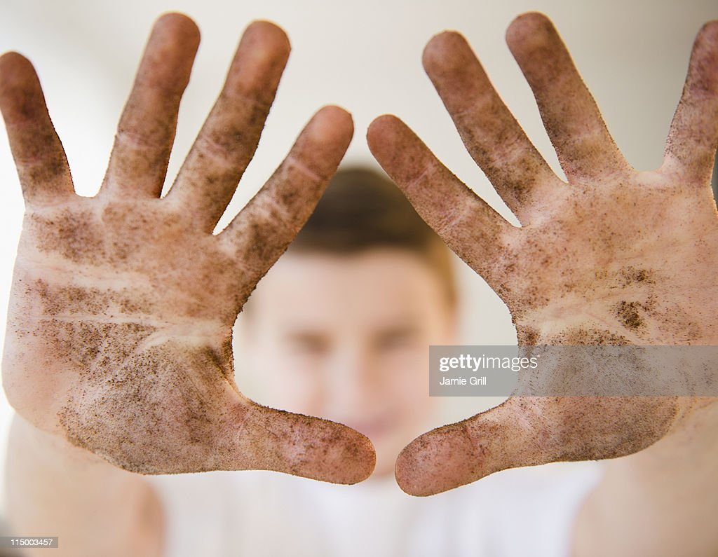 Young boy showing off dirty hands : Stock Photo