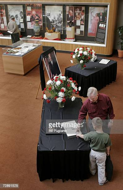 A young boy signs a condolence book at the Gerald R Ford Presidential Library December 28 2006 in Ann Arbor Michigan The former US President Gerald...