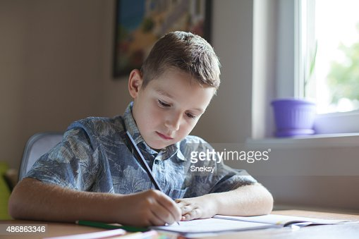 Boy Working Out Maths On A Chalk Board Stock Photo  Royalty Free