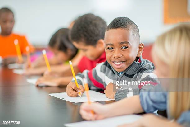 Young Boy Sitting Happily in Class