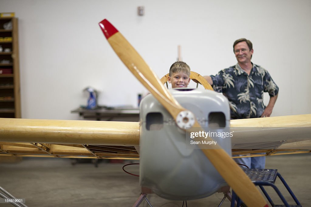 Young boy sitting In a small airplane : Stock Photo