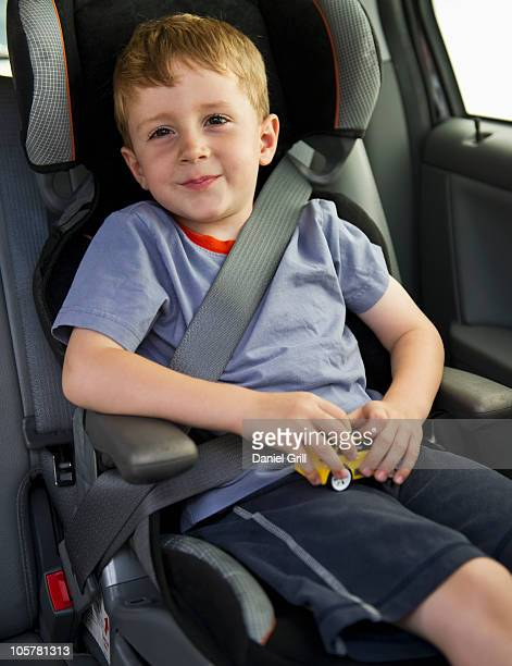 Young boy sitting in his car seat