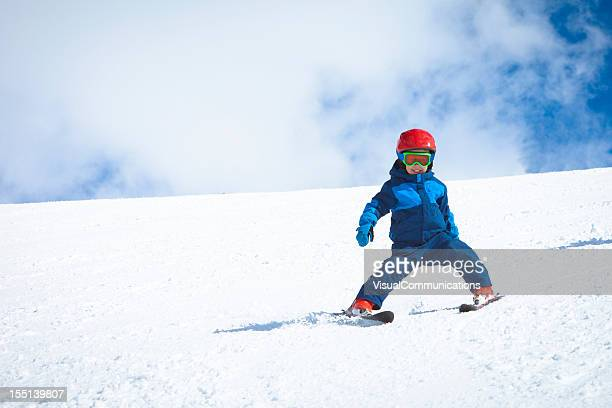 young boy skiing.