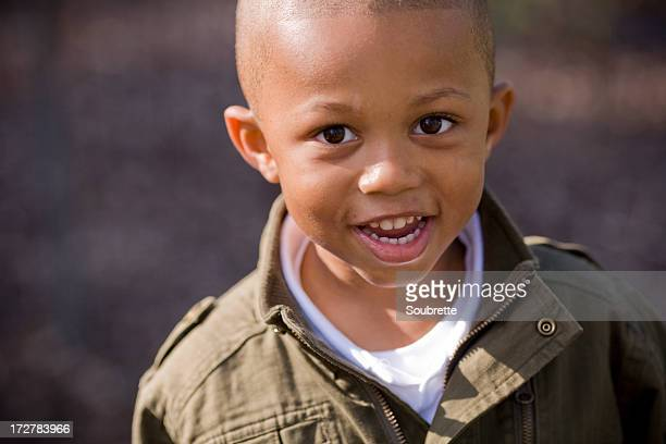 Young boy smiling for a picture for his parents