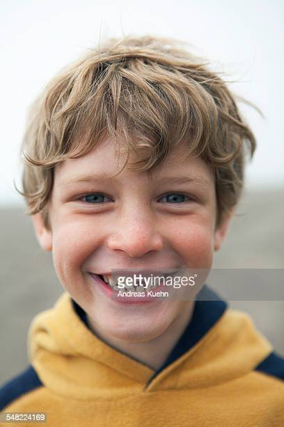 Young boy smiling with a tooth missing