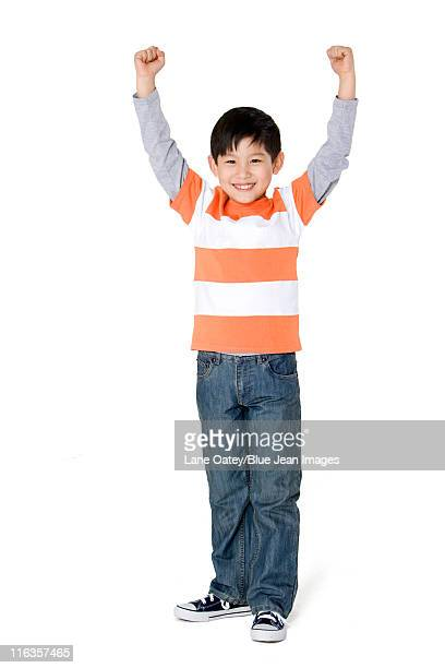 Young boy smiling with arms outstretched