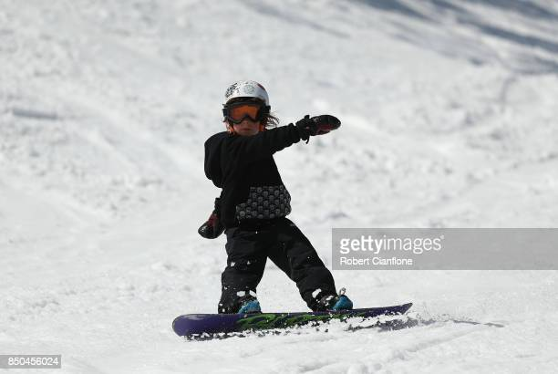 A young boy snowboards on September 21 2017 in Mount Buller Australia Australians are enjoying one of the best ski seasons after the best snowfall in...