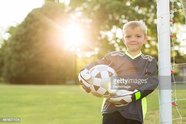 Young Boy Soccer Goalie Stands at Goal