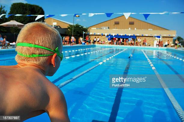 Young Boy Sports Athlete Swimmer Ready to Race in Pool