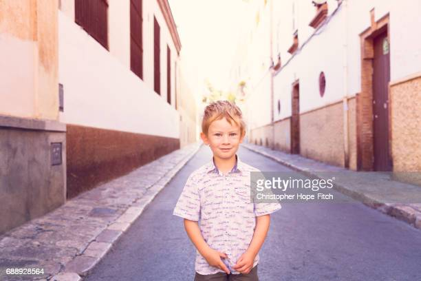 Young boy standing in a Spanish street