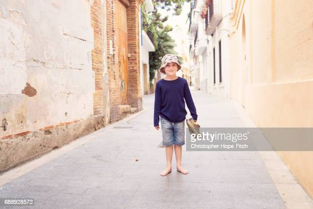 A young boy standing in a Spanish street