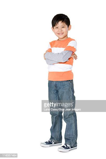 Young boy standing with arms crossed