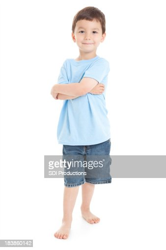 Young Boy Standing With Arms Crossed, White Background