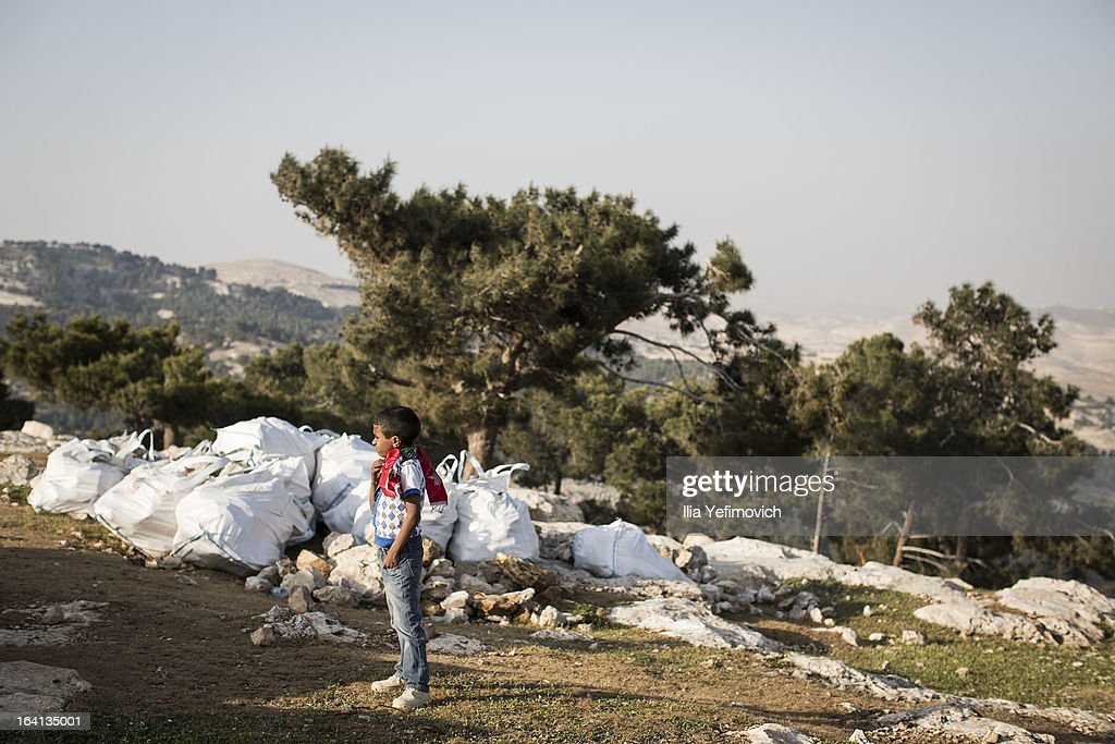 MA'ALE, ADUMIM, WEST-BANK - MARCH 20: A young boy stands as Palestinians erect protest tents in a camp on March 20, 2013 in the E1 area next to Ma'ale Adumim. The action took place at the same time as U.S. President Barack Obama arrived to Ben Gurion airport near Tel Aviv. This will be Obama's first visit as President to the region, and his itinerary will include meetings with the Palestinian and Israeli leaders as well as a visit to the Church of the Nativity in Bethlehem.