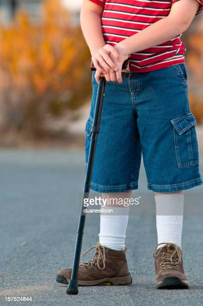 Young Boy Stands in Street