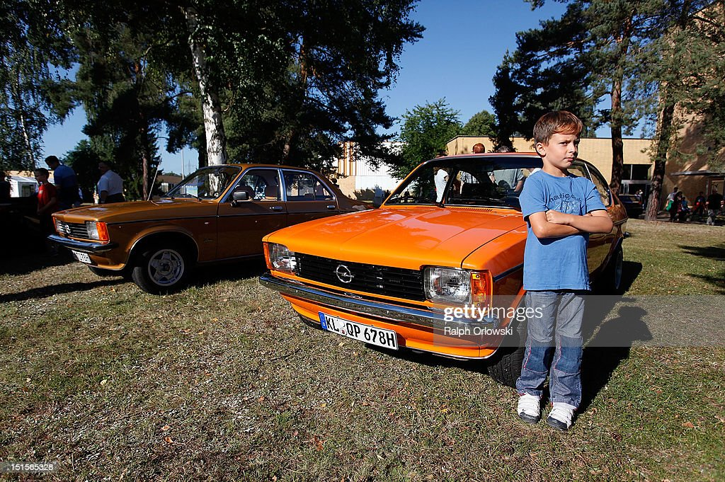 A young boy stands next to an historic Opel Kadett at the manufacturing plant of German car maker Adam Opel GmbH on September 8, 2012 in Kaiserslautern, Germany. Automaker Opel, founded in 1862, celebrates their 150th anniversary.