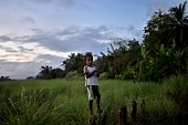 A young boy stands on stilts at sunset in the town of Kerema Papua New Guinea on September 10 2014 AFP PHOTO / ARIS MESSINIS