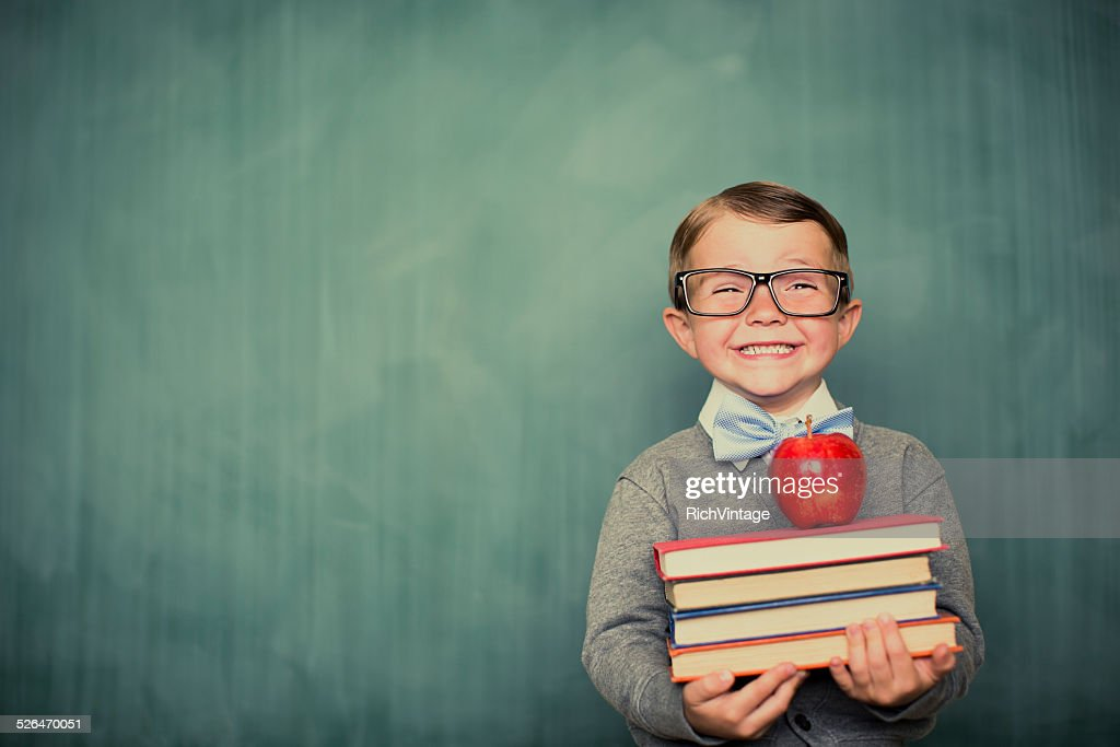 Young Boy Student Dressed as Nerd Holding Books : Stock Photo