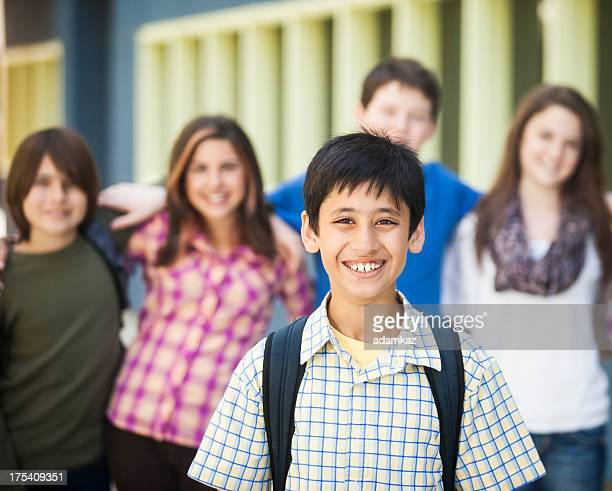 Young Boy Student with Friends in Background