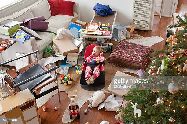 Young boy surrounded by opened gifts on christmas