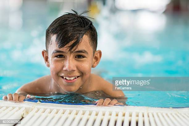 Young Boy Taking a Swim Class