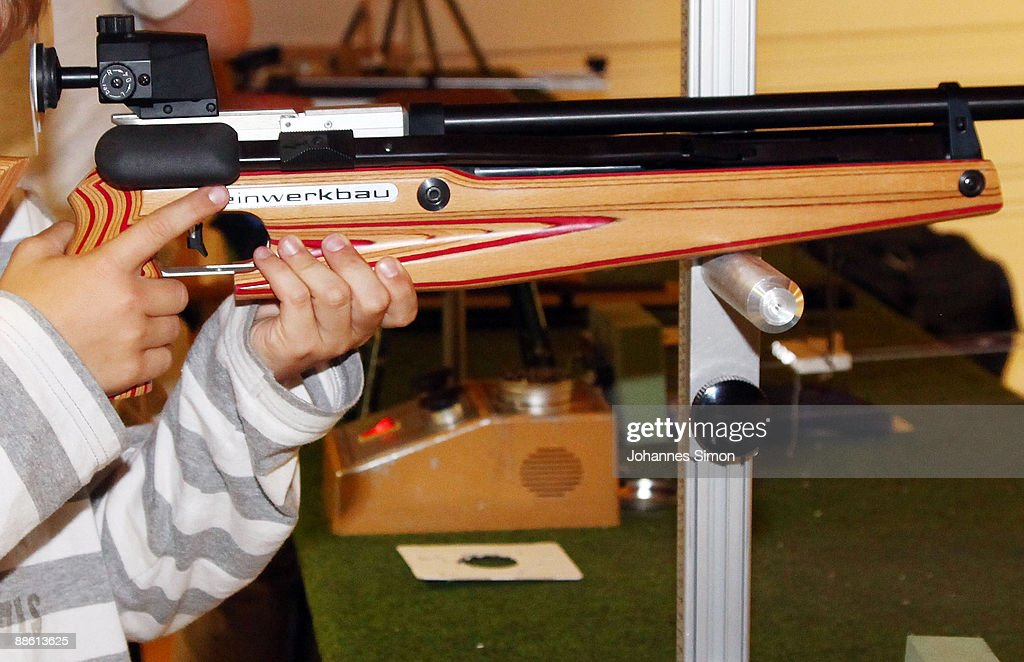 A young boy tests sporting arms during a familiy open day of shooting club 'Gut Ziel' ('Aim Well') on June 21, 2009 in Olching-Geiselbullach, Germany. After Winnenden school shooting gun control debate is continued in Germany. In Olching parents are astonished about school officials who plan an installation of a shooting stand in the dwelling of recently built school.