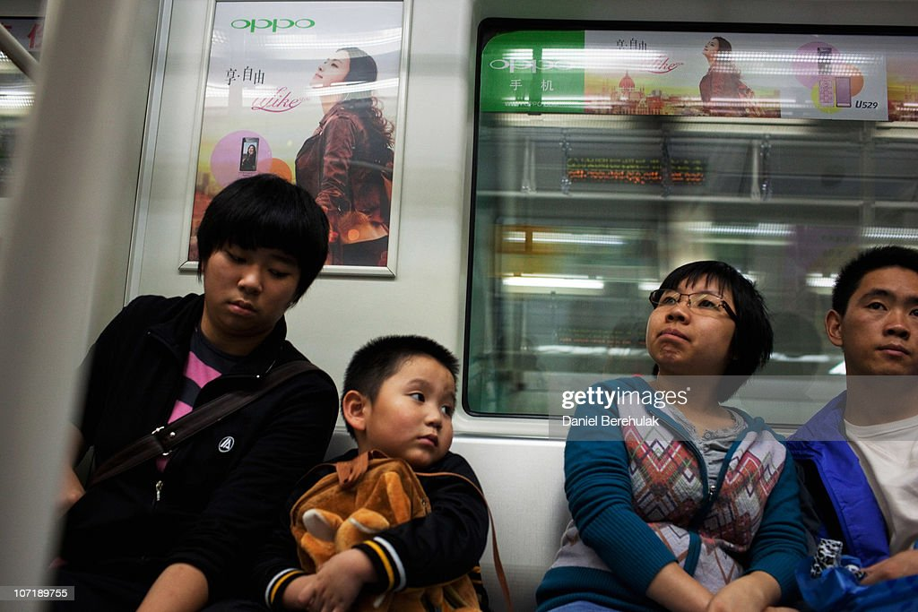 A young boy travels with his family on the metro on November 28, 2010 in Shenzhen, China. According to the US Commercial Service, Shenzhen is one of the fastest growing cities in the world, mainly due to being southern China's major financial centre. The city is home to the Shenzhen Stock Exchange as well as the headquarters of numerous technology companies. It is also a major centre for foreign investment and trade, importing more goods than any other city in China and was recently ranked by the World Bank as having the second best investment climate for foreign firms and third most effective local government in all of China. Shenzhen is also the third busiest container port in China, ranking only after Shanghai and Hong Kong.