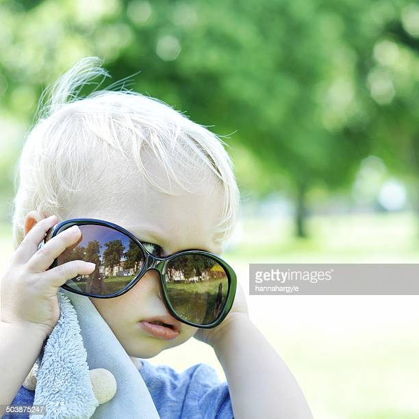 Young boy trying on sunglasses