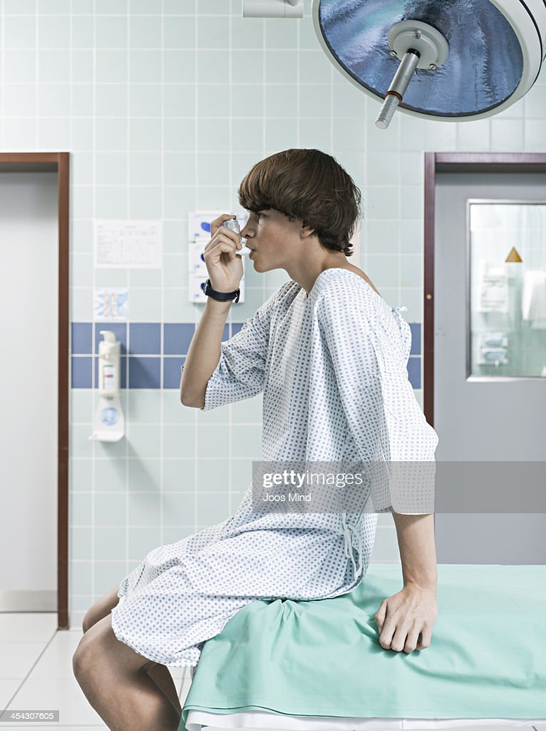 young boy using asthma inhaler : Stock Photo
