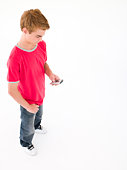 Young boy using cellular phone