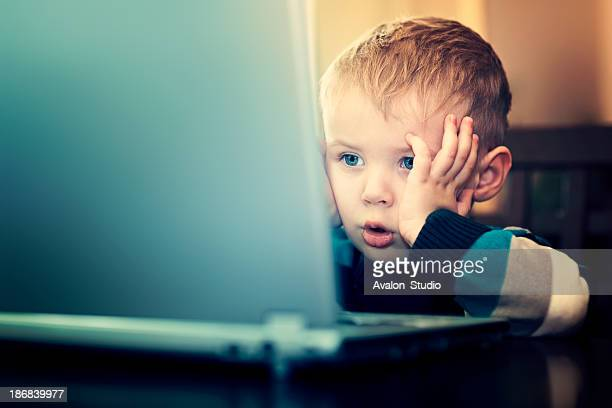 Young boy using laptop computer