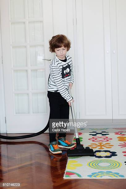 Young boy vacuuming