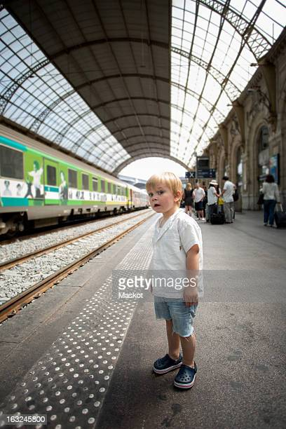 Young boy waiting for train